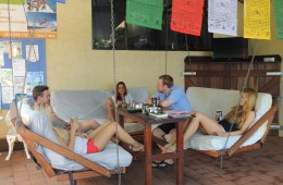 You can chill out in the hanging chairs at the Reef Lodge Backpackers in Townsville. Catch up with friends and tell a story or two.